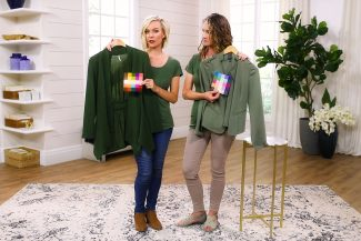 Sarah and Anne wearing and holding green tops in their own Types